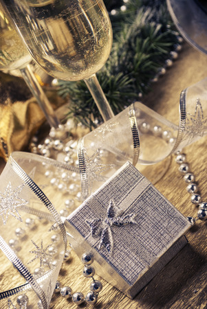 Silver present box and champagne glasses with christmas decoration. photo