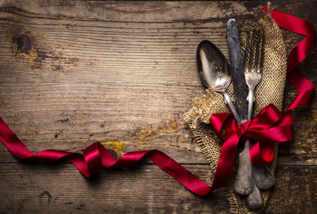 wooden spoon: Vintage silverware decorated with red ribbon