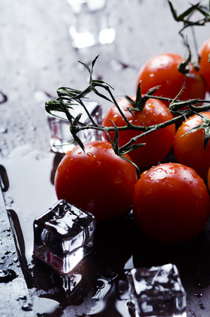Cherry tomatoes and ice cubes photo