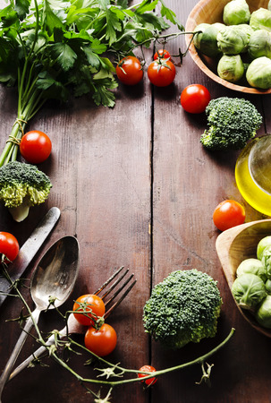 arranged: Food ingredients arranged on wooden table with copyspace