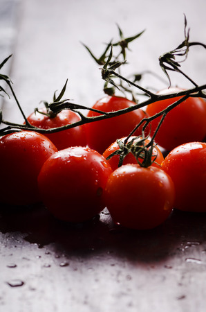 Close up of cherry tomatoes with water drops. photo