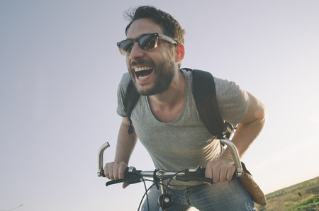 Man with bicycle having fun. retro style image. Stockfoto