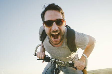 exercise bike: Man with bicycle having fun. retro style image. Stock Photo