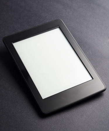 Ebook reader on black background with white screen.