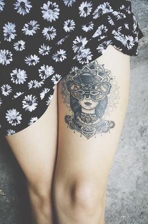 hot legs: Attractive female leg with tattoo