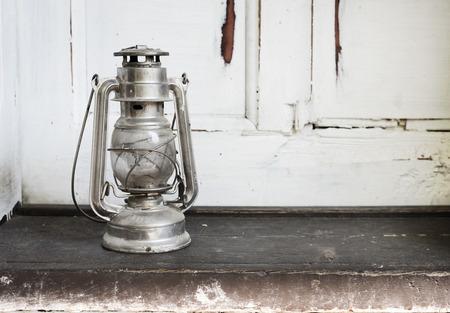 doorstep: Vintage lantern on rustic wooden doorstep