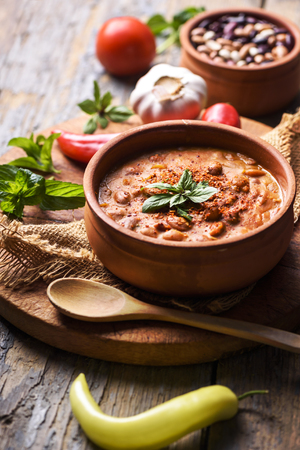 baked: Spicy baked beans in traditional clay pot. Stock Photo