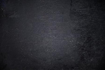 Grungy black textured metal background Standard-Bild