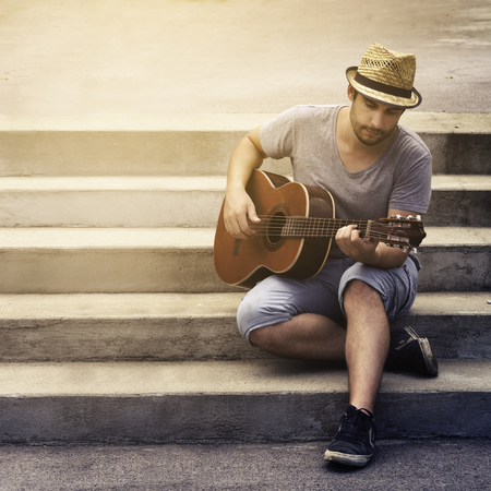 playing: Man playing guitar on the street Stock Photo