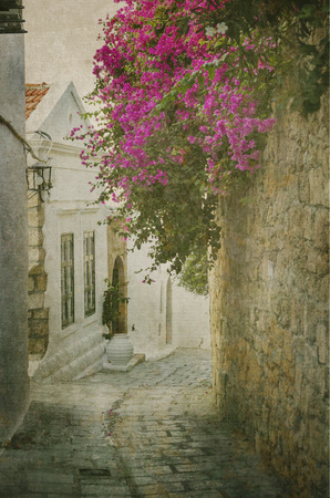 old houses: Old street in Lindos, Rhodes island, Greece. Texture added. Stock Photo