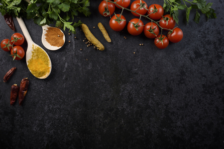 Food ingredients and various spices on black rustic background Stockfoto