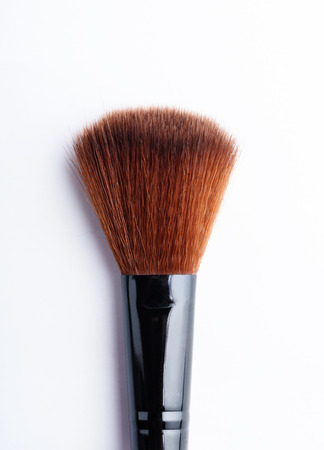 Professional makeup brush closeup isolated over white background.
