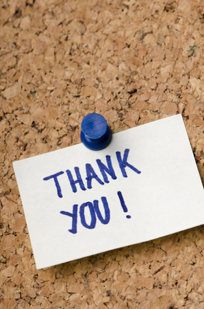 note board: Thank you message on sticker note pin on cork office board. Business concept. Stock Photo