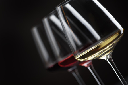 cabarnet: Three glass of red, rose and white wine over black background. Wine card menu design.