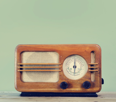 Old style vintage radio over retro mint background with copyspace design. Stock Photo