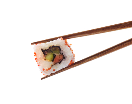 Closeup of traditional japanese sushi roll with salmon and tuna fish on bamboo chop sticks isolated on white background. Sushi bar menu design with copyspace.