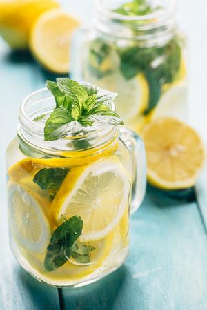 Mint lemonade in mason jars on retro blue wooden table