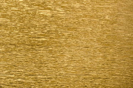 Abstract golden textured background with christmas wrap paper decoration. Xmas and new year design backdrop.
