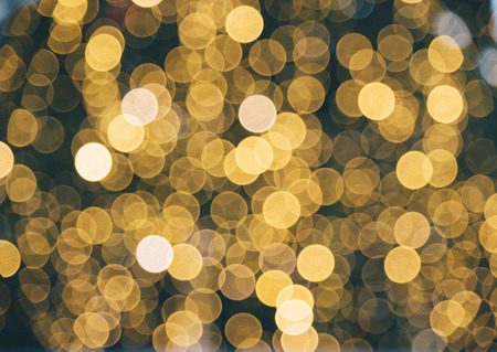 Golden blur background. Christmas holiday natural bokeh with defocused night lights. Stock Photo