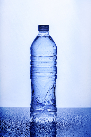 Fresh drinking mineral water in plastic bottle on white background. Healthy living concept.