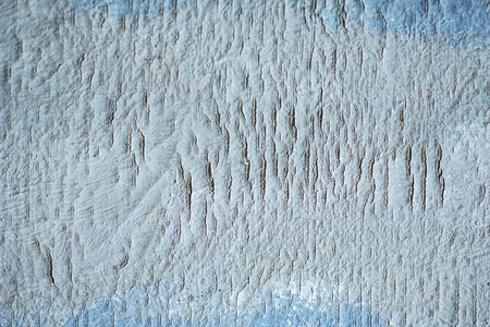 Abstract art canvas background with crack texture. Artistic design backdrop with blue oil paint.