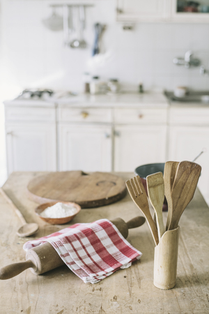 Vintage kitchen interior with kitchen utensils prepared for cooking Фото со стока