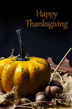 Thanksgiving dinner invitation card. Happy thanksgiving and give thanks concept. Autumn pumpkin and crops decorate thanksgiving dinner table. Фото со стока