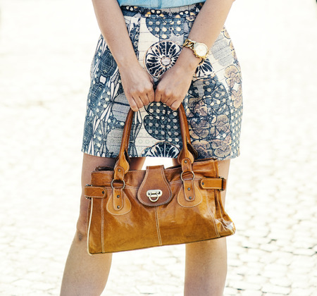 2894be842421 Stylish lady holding luxury natural leather handbag in hands.