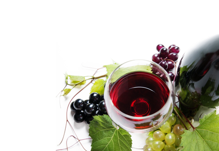 Top view of glass of red wine and bottle with grape vine isolated over white background. Wine tasting border design banner. Wine art shop and winery concept. Фото со стока