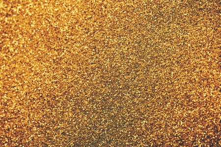 Golden glitter textured for christmas and new year celebration party. Фото со стока