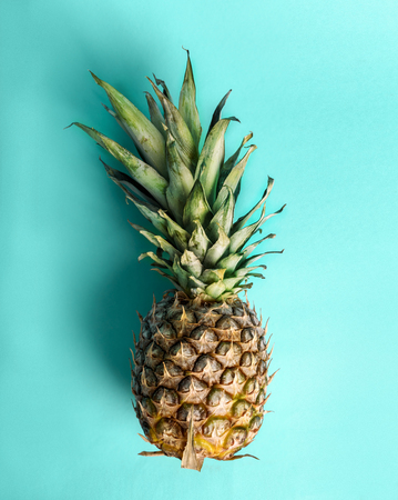 Top view of pineapple on retro bright blue