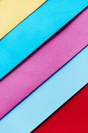 Trendy pastel colors in geometry shape flat lay. Colorful rainbow paper creative linear Stock Photo