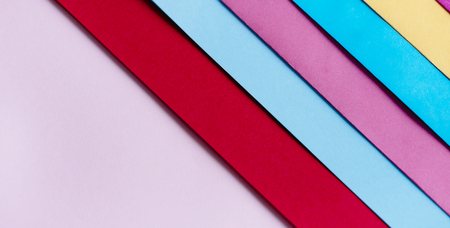 Trendy pastel colors in geometry shape flat lay. Colorful rainbow paper creative linear Banco de Imagens