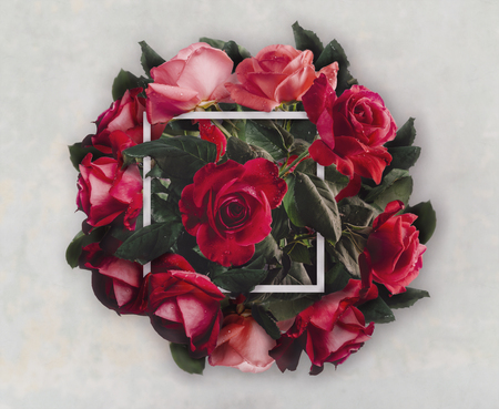 Beautiful red roses bouquet for valenties day gift. Creative wedding flower decoration. Vintage valentine present with floral bloom and frame. Top view.