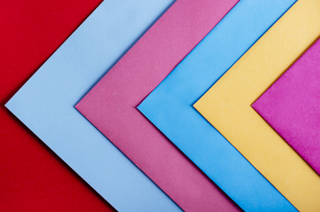 Trendy pastel colors in geometry shape flat lay. Colorful rainbow paper creative linear background. Abstract minimal vivid art design. Banco de Imagens