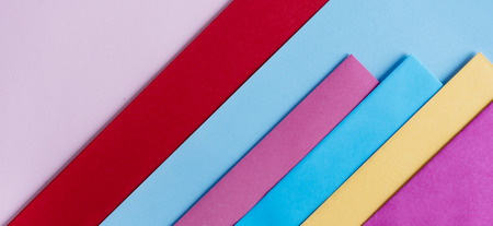 Trendy pastel colors in geometry shape flat lay. Colorful rainbow paper creative linear background. Abstract minimal vivid art design.