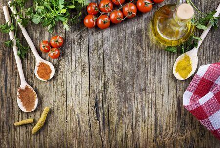 Top view of various food ingredients on vintage wooden table. Banco de Imagens