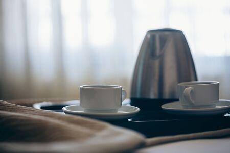 Morning breakfast with black coffee in bedroom.