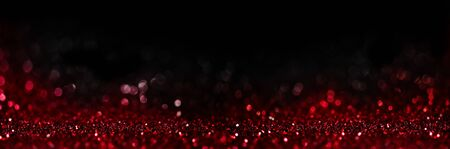 Abstract blur red glitter on black background. Card for Valentine's day, christmas and wedding celebration. Love bokeh sparkle confetti textured layout. Classy elegant design.