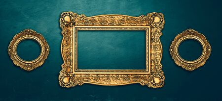 Vintage luxury golden frames set with ornate baroque decoration on rustic textured wall background. Retro fancy picture frames for interior design. 版權商用圖片