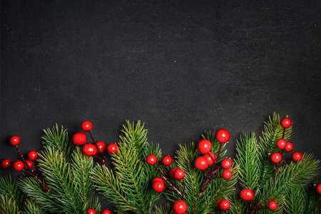 Christmas background border with christmas pine tree decor on vintage dark table. Top view. Winter holiday greeting card design. Happy new year banner. Фото со стока
