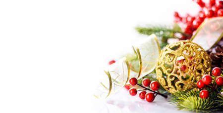 Golden chrismtas ornament ball with fir tree and gold ribbon isolated on white background. Happy new year greeting card design. Luxury celebration decor banner layout.