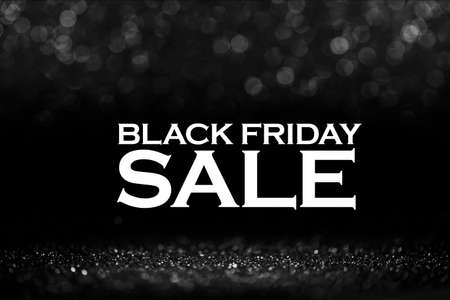 Black friday bokeh background. Elegant dark blur layout design. Silver and black glitter place on table with spotlight. Luxury abstract banner with copyspace.