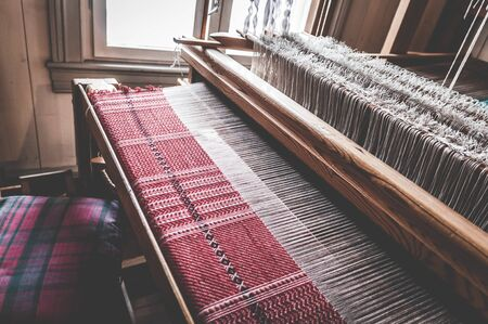 Traditional old vintage weaving loom as a professional handwork manufacturing tool for handmade weave production in a textile workshop. Stock Photo
