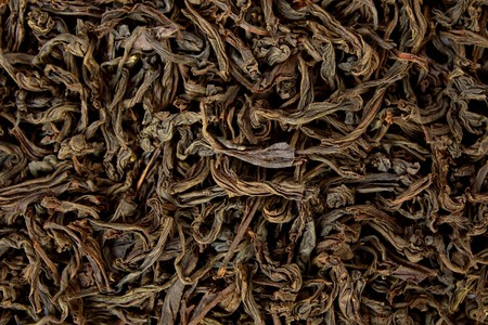 Close-up of dried black tea leaves as a background photo