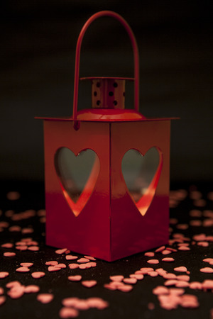 red lantern: a red lantern on a black background covered with red hearts