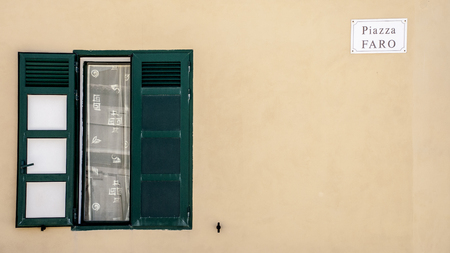 ragusa: a green window in the Lighthouse Square in Punta Secca, Ragusa