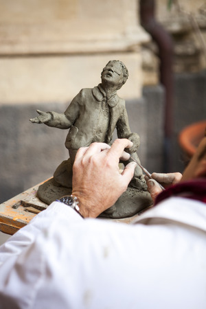 sculptor: A sculptor who works in clay work