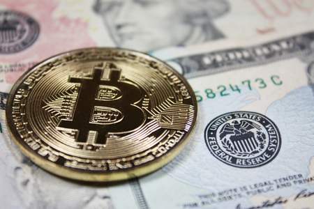 Bitcoin concept on United States currency.
