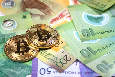 Bitcoin concept on foreign currency in a variety of denominations. Stock fotó